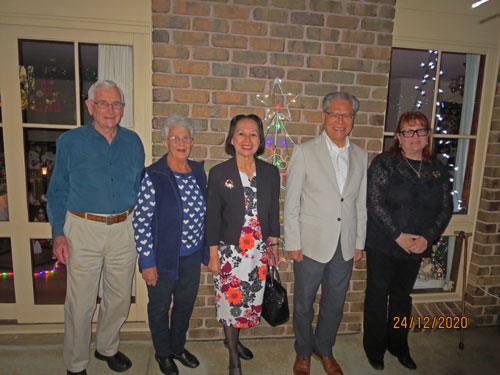 Bill, Peg, Mrs. Le, His Excellency the Honorable Hieu Van Le, Governor of