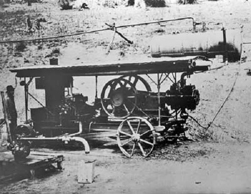a steam engine and compressor used during the construction 