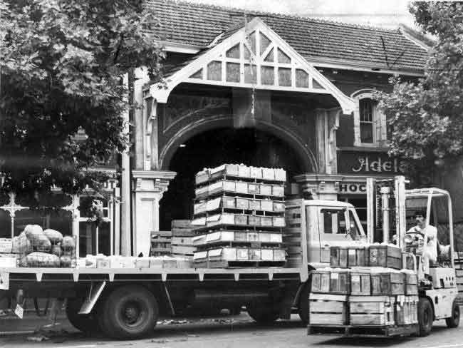 Another photo taken in 1976 -- Trucks unloading outside the market.